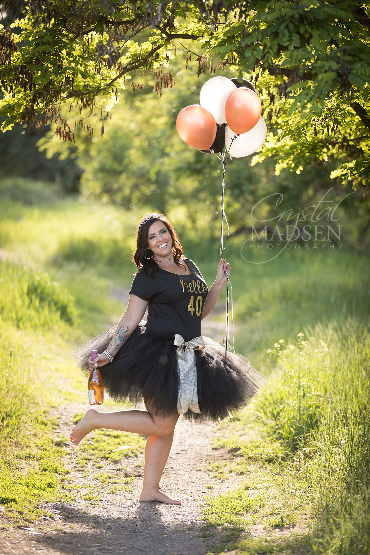 40 year old birthday girl with balloons and tutu